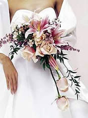 Bride with pink lily and rose cascade bouquet.