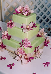 Lime green wedding cake with pink orchids.